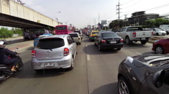 Motorcycle Riding with Traffic Jam in Bangkok, Thailand. Stock Footage