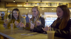 Teens Play With Straw Wrappers In A Coffee Shop, Girl Gets Up To Get Her Drink Stock Footage