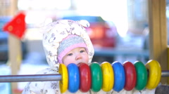Baby girl playing with multicolor abacus in winter 4k UHD (3840x2160) Stock Footage