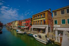 MURANO, ITALY - JUNE 16, 2015: Murano street with traditional houses and shops - stock photo