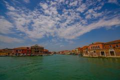 MURANO, ITALY - JUNE 16, 2015: Murano panoramic view from a boat outside on - stock photo