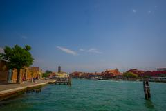 MURANO, ITALY - JUNE 16, 2015: Murano city view from the port, nice blue water Stock Photos