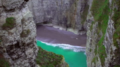 Empty private beach with azure water hidden between cliffs, paradise on earth Stock Footage