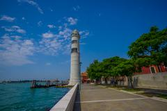 MURANO, ITALY - JUNE 16, 2015: Murano lighthouse at the port, nice view of the Stock Photos