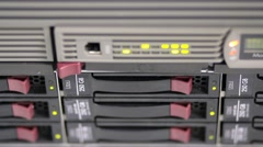 Blinking LEDs of server stack with hard drives in a datacenter - stock footage