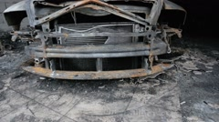 pan footage of burned out car in garage - stock footage