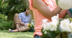 Close up of mother and daughter watering flower pots Stock Footage