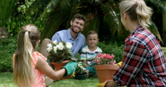 Family having a discussion while gardening together Stock Footage