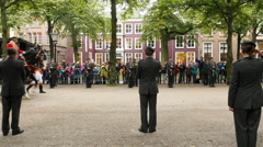 The King's Carraige Rides Past the Military - The Hague Netherlands Stock Footage