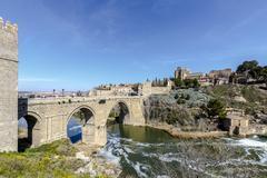 Puente de San Martin bridge over the Tajo river in Toledo - stock photo