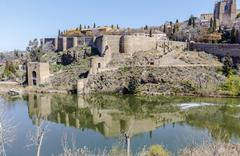 defensive walls on river Tagus in toledo - stock photo