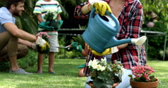 Happy family gardening together Stock Footage
