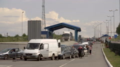 The queue of cars at the checkpoint of the state border with Poland Stock Footage