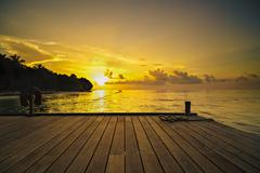 beautiful sunset in luxury resort in the tropics - stock photo