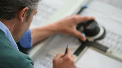 Architect designing on drawing table Stock Footage