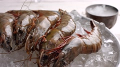 Raw shrimps on ice. Stock Footage