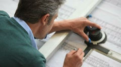 Architect designing on drawing table - stock footage