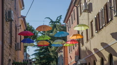 Umbrellas on electric wires Stock Footage