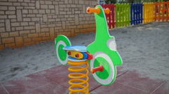 Green wooden pony in the playground Stock Footage
