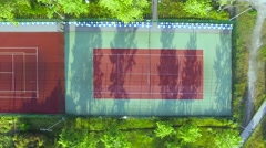 Aerial footage. Flying over tenis court, basketball court and trainers Stock Footage