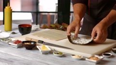 Hands of man preparing sushi. Stock Footage