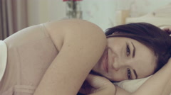 Lovely girl lying in bed Stock Footage