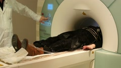 4k, Doctor makes an MRI to the patient  at the hospital Stock Footage