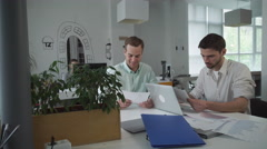 Happy professional workers in modern office Stock Footage