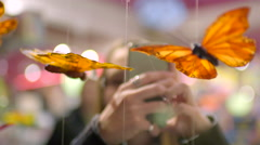 Teen Takes Photos Of A Handmade Butterfly Mobile In Window Display Of A Store Stock Footage