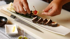 Hands put sushi on plate. Stock Footage