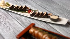 White plate with sushi rolls. Stock Footage
