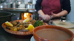 Portuguese gastronomy - traditional pork meat dish. - stock footage