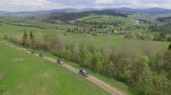 Suv Convoy Traveling Through the Mountains of the Carpathians. the Camera Flies Stock Footage