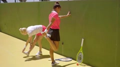 Two women warming up before playing tennis Stock Footage