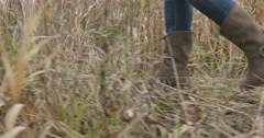 Female feet in boots running along autumn road. - stock footage