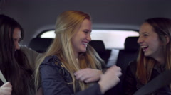 Girls Buckle Their Seat Belts In The Back Seat Of Car, They Laugh And Talk - stock footage