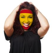 girl with spanish flag face paint - stock photo