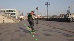 Young man doing a virtuoso tricks on roller skates Stock Footage