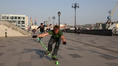 Young guys doing tricks on roller skates Stock Footage