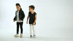 Little Stylish Kids Dancing And Having Fun, Isolated On White Studio Shot - stock footage