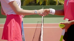 Two female tennis opponents shaking hands Stock Footage
