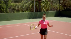 Angry young tennis player disputing a line call Stock Footage