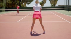 Two sporty young women playing a game of tennis Stock Footage