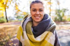 Portret of a beautiful young girl in park. Autumn time. Stock Photos