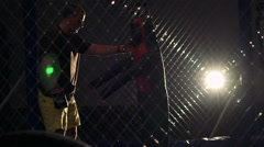 Athlete hitting punching boxing bag- mannikin in the dark gym. Slowly - stock footage