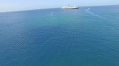 Panoramic of ferries, island and ocean - stock footage