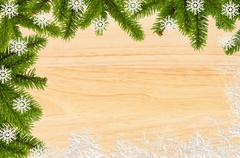 Vintage christmas background - old wood board with green christmas tree branc - stock photo