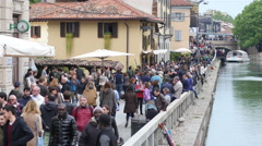 Crowd people tourists walking along Darsena water channel in Milan Italy Stock Footage