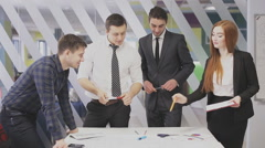 Team of professionals discusses the project, brainstorming in a business meeting Stock Footage