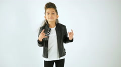 Portrait of Stylish Little Girl In Casual Style Clothes Dancing And Having Fun - stock footage